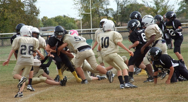 Image: The A-Team Gladiator defense crunches a Palmer runner.