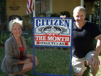 Image: Victor Carera with his wife pose for their picture of in front of the Citizen of the Month sign!