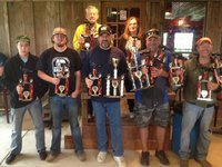 Image: Cook off winners top left: Howard Hobbs (holding trophy for Daryl Hobbs), Dee Richie Holveck Bottom left: JD Wilker (holding trophy for Daryl Hobbs), Payton Day, Daryl Hobbs, Dennis Deward, Waylon Bowers.
