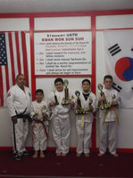 Image: Pictured are some of these students from the Italy area. Master Charles Kight-Chief Instructor of the school, Nick Sam-Italy, Rocklin Ginnett-Italy. Michael Gonzales-Italy and Michael Russell-Italy, Isamar and Mario Perez-Black Belts from Milford were not available for the picture.