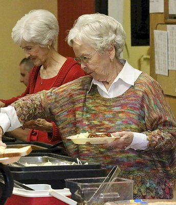 Image: Frances Holley and her sister, Nedra Hooser lend their support while enjoying their meal.