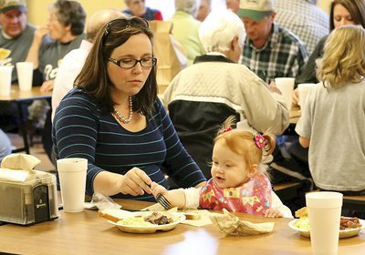 Image: All ages attend the dinner to raise scholarship money for selected Italy High school graduates. Mary Beth and Whitley Wainscott enjoy their meal.