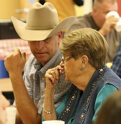 Image: Curtis Riddle chats with Lois Helen Reeves while enjoying the fundraising feast.