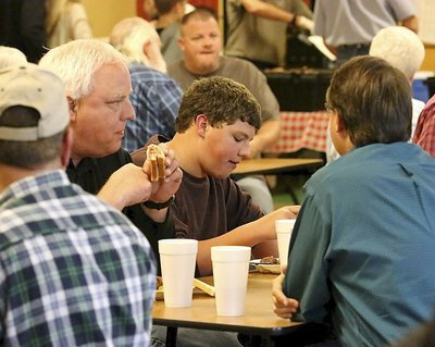 Image: Steven Crowell and son Thomas enjoy Bubba's brisket.