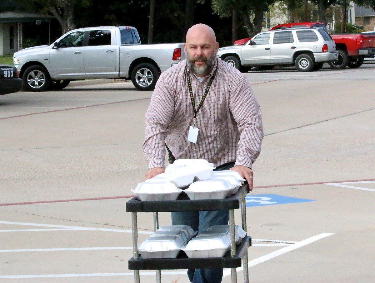 Image: Italy HS Principal Lee Joffre rolls into the dome with donated meals from Hillsboro's Black-eyed Pea for Milford's evacuees.