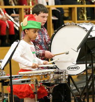 Image: 6th graders Aliyah Turner and Hunter Hinz help get the 2013 Italy Christmas Concert underway.