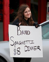 Image: Drum major Alexis Sampley drums up business outside the Uptown Cafe for the Italy Gladiator Regiment Band's annual spaghetti dinner.
