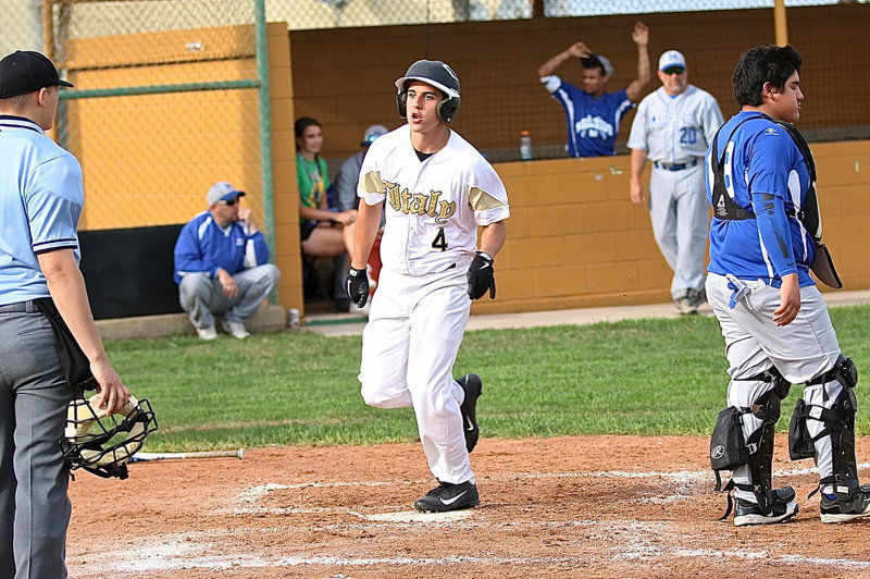 Image: Mason Womack(4) crosses home plate thanks to double from teammate Austin Crawford.