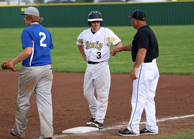 Image: Eli Garcia(3) receives a fist bump from Coach Cate with Garcia representing the winning run on first. Celis then entered the game to pinch run for Garcia.