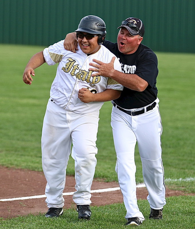 Image: Coach Cate congratulates Pedro Salazar(12) after Salazar pulls thru with the game winning walk off hit. Italy's JV beats Milford 8-7 thanks to Salazar's heroics!