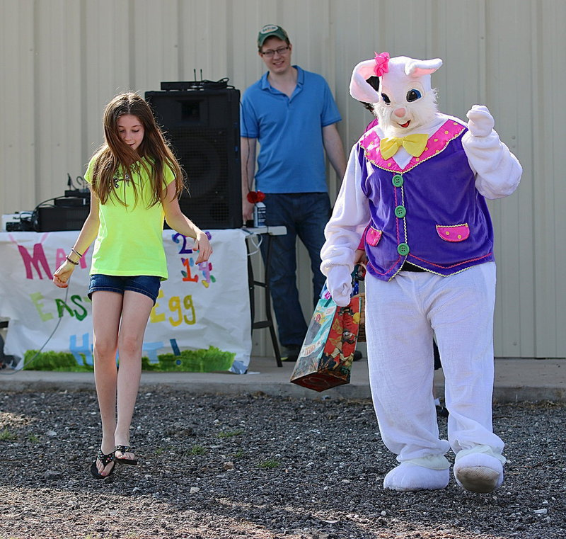 Image: The Easter Bunny, with Breyanna Beets inside the suit, joins in some line dancing with the kids to kickoff the annual Mayor's Easter Egg Hunt at Upchurch Ballpark Saturday morning.