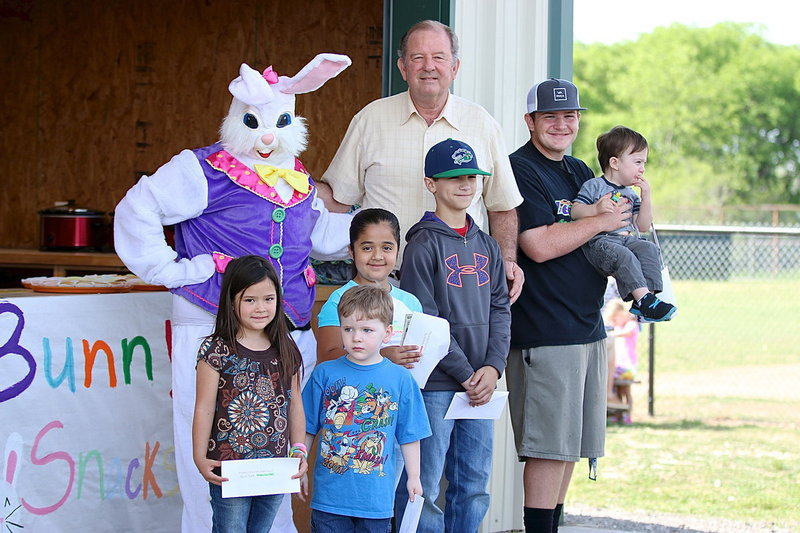 Image: City of Italy Mayor James Hobbs gets help from the Easter Bunny, Breyanna Beets, and from Gladiator Baseball star Tyler Vencill to help congratulate the prize winners who found the money eggs!