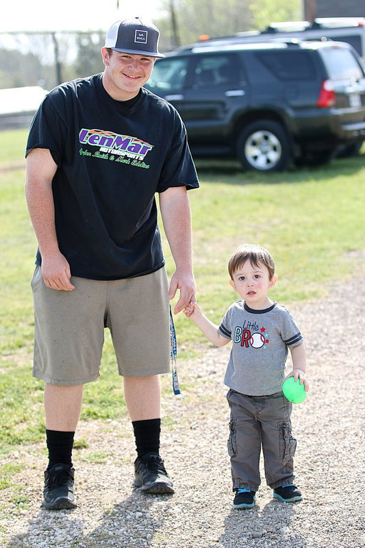 Image: Tyler Vencill escorts the big winner, Bentley Gossett, who found the $25.00 money egg!