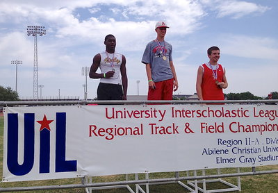 "Image: Italy Gladiator senior TaMarcus Sheppard achieving (Left) is presented his silver medal at the champions' podium after achieving a personal best in the high jump of 6',3"" during the UIL Regional Track And Field Championship in Abilene at the Abilene Christian University campus."
