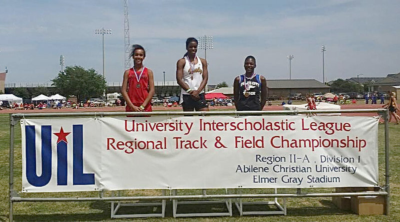 Image: Italy Lady Gladiator junior, Kortnei Johnson (center) is presented a gold medal at the champions' podium for her 100m dash time of 11.3. Johnson also earned a gold medal in the 200m dash with a time of 23.6 during the UIL Regional Track And Field Championship in Abilene at the Abilene Christian University campus. Johnson is state bound in three events, including the sprint relay.
