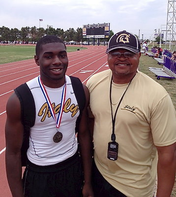 Image: Senior Gladiator TaMarcus Sheppard with his pops and coach, Bobby Campbell. Sheppard is state bound in the high jump event!