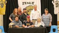 Image: Italy Gladiator Football's Zain Byers, signs his commitment letter to play football for the Austin College Kangaroos in the fall of 2014. A signing party was held in Zain's honor at the Italy High School campus on Wednesday. Back row (L-R): Katie Byers (cousin), Brentley Byers (uncle), Barry Byers (father), AD/HFC Charles Tindol and Nancy Byers (aunt). Front row (L-R): John Byers (cousin), Zain Byers and Ann Byers (grandmother).