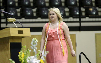 Image: Jesica Wilkins returns to the stage to accept her Cosmetology Certification.