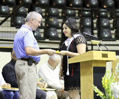 Image: David Shoeford presents a Lone Star Cyclists Scholarship to Monserrat Figueroa.