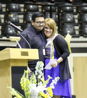 Image: Jesus Perez presents one of the Italy High School Band Booster Scholarships to Emily Stiles.