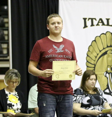 Image: Bailey Walton receives the Walter Upchurch Memorial Scholarship.
