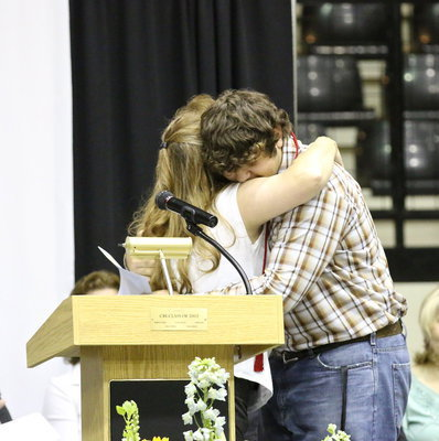 Image: Flossie Gowin hugs Lion Club scholarship recipient, and son, Kevin Roldan. Joseph Sage, Emily Stiles and Taylor Turner were also recipients.