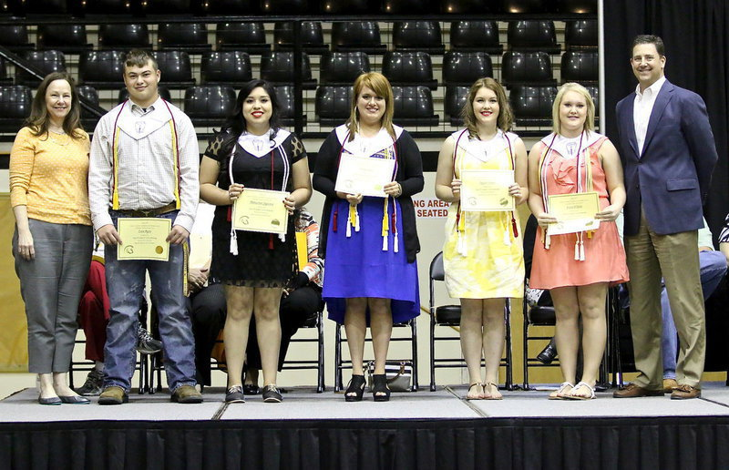 Image: During the 2014 Senior Scholarship and Award Program, Italy ISD George E. Scott Memorial Scholarships were awarded to Zain Byers, Monserrat Figueroa, Emily Stiles, Taylor Turner and Jesica Wilkins. Presenting the scholarships were Mr. Scott's daughter, Diana Herrin (far left), and son, Tom Scott (far right), both graduates of Italy High school themselves. Each student receives $500 per semester throughout college.
