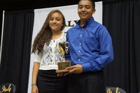 Image: Chris Munoz is the 2014 recipient of the Margaret Oliphant Cup, presented by Vanessa Cantu, 2013 recipient.