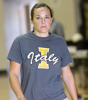 Image: Assistant volleyball coach Holly Bradley has her serious face on during two-a-day workouts.