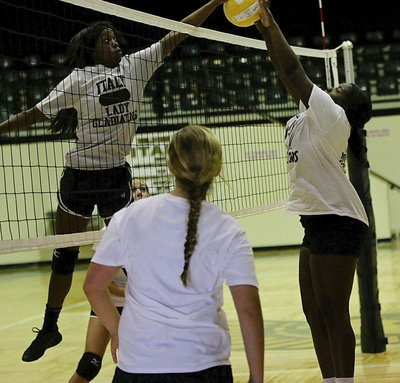 Image: Senior Kortnei Johnson jousts with teammate Taleyia Wilson.