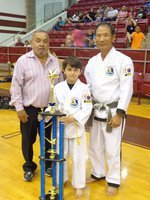 Image: Pictured is Master Charles Kight, chief instructor of the Hillsboro TKD school,  Antonio and Grand Master Park co-founder of Unified TKD.