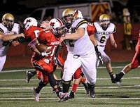 Image: Aaron Pittmon(72) bullies his way into the Maypearl backfield to tackle a Panther for a loss.
