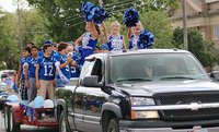 Image: Here come the Milford Bulldogs with their cheerleaders Gabby Rose, Corrie Dawkins and Evy Ewing leading the yells during the school's 2014 Homecoming Parade as it convoys thru downtown Milford.