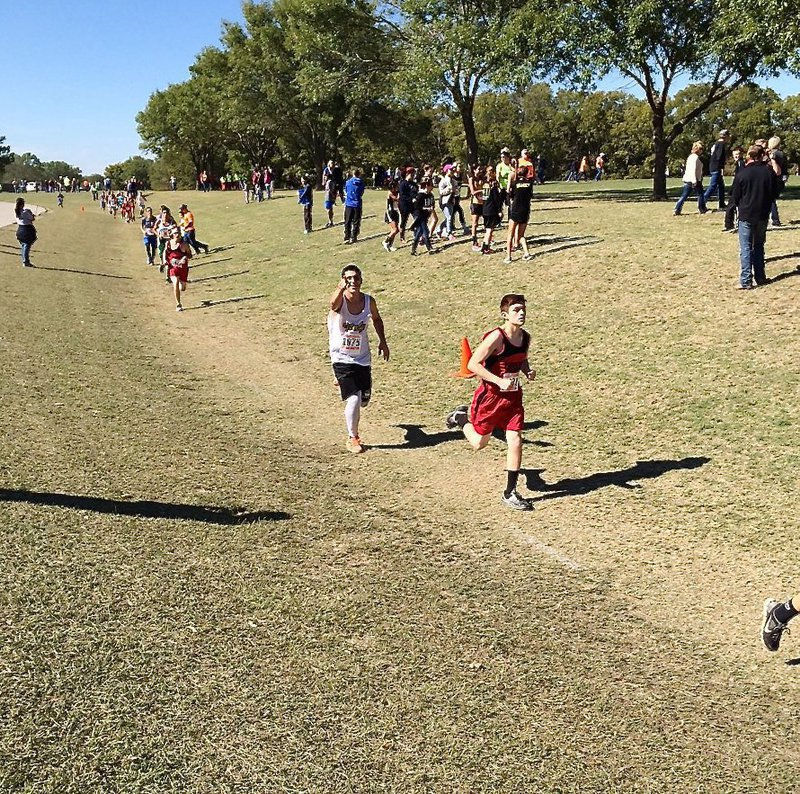 Image: Mason Womack finds the camera while representing Italy as the first male athlete from Italy to compete during a UIL regional cross country meet in recent times.