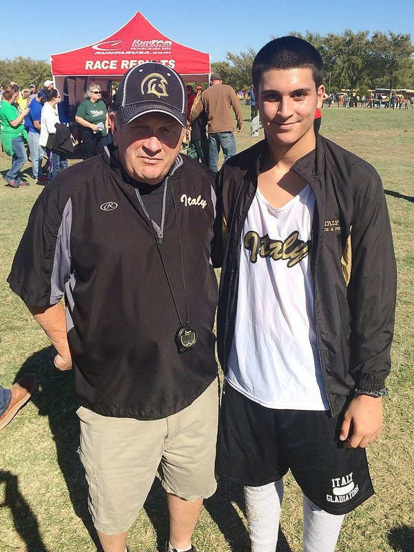 Image: Cross country head coach Johnny Jones with Italy junior Mason Womack who represented Italy during the UIL regionals this year. The stories these two could tell…