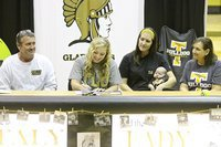 Image: Father and Italy ISD school board member Russ Lewis, sister Megann Lewis Harlow and her new son Renndon James Harlow and mother Kelly Lewis look on as Jaclynn Lewis begins signing her commitment letter to play softball for Texas Lutheran University.