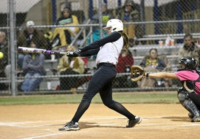 Image: Italy's Lillie Perry tries to finish off South Grand Prairie with a mighty swing of the bat.