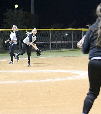 Image: Third-baseman Brycelen Richards throws to fellow freshman Jenna Holden at first-base for an Italy out.