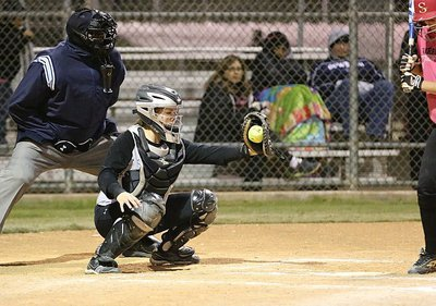 Image: Catcher Lillie Perry squeezes a strike from her pitcher, Jaclynn Lewis.