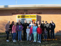 Image: Front row: Bailey Eubank, Oralia, Taylor, Kaylee, Shamiyah, Isaac, JR Back Row: Madison Washington, Alexis Sampley, Officer Elliott, Chief Martin, Firefighter Kimmons, Capt. Cate, Officer Click, Officer Saxon, Sgt Pitts, Officer Cherry, Lt B. Chambers