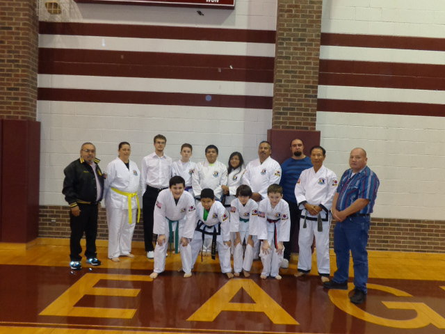 Image: Pictured are the following students, Masters and instructors.     Top row:  Master Charles Kight-Hillsboro, Jennifer Procopio-Italy, Kevin Devers-4th Degree Black Belt-West,  Michael Russell-Italy, Mario Perez, Black Belt-Milford, Isamar Perez-Black Belt-Milford, Roger Sam-Italy, Master Kevin Kight-Lorena, Grand Master Park-Houston, and     David Jones-Malone.     Second  Row:  Rocklin Ginnett-Italy, Nick Sam-Black Belt-Italy, Antonio Procopio-Italy, and Jacob Young-Hubbard