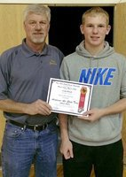Image: Italy Gladiator senior Cody Boyd was chosen as an Honorable Mention member of the 2014-2015 Academic All-State Team as voted on by the Texas High School Coaches Association in conjunction with the United States Marine Corps. Boyd had a 3.207 GPA during his senior season and maintained a 92 GPA or higher throughout all four years of high school. Presenting Boyd with his certificate is Italy High School Athletic Director/Head Football Coach Charles Tindol.