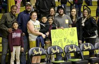 Image: Italy 8th grader Reagan Jones(22)  had plenty support from family members who was on hand for her final junior high basketball game. By the way, the back of the sign mentioned that #22 was not afraid to foul out.