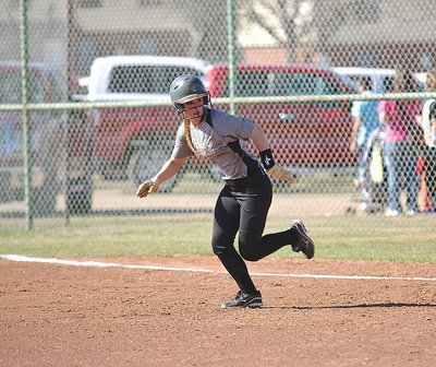 Image: Lady Gladiator Bailey Eubank(1) hustles over to second-base.