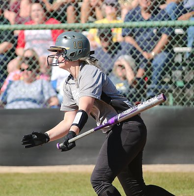 Image: Senior Madison Washington(10) hits a liner and then turns a triple for the Lady Gladiators.