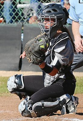 Image: Italy catcher April Lusk(7) clasps a strike from her pitcher, Jaclynn Lewis.