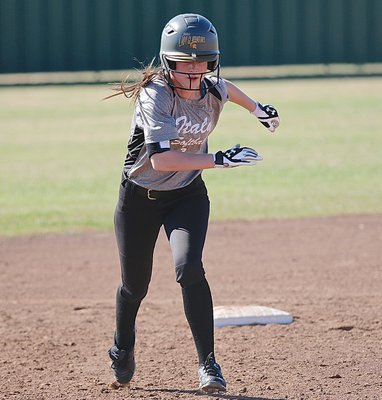 Image: Lady Gladiator Cassidy Childers(3) takes off for third-base.