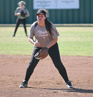 Image: Lady Gladiator first-baseman Jenna Holden(11) is tuned in during the pitch.