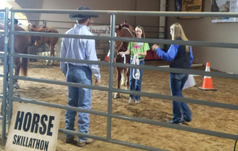 Image: Gentry Rogers of Milford demonstrates her ground skills around horses to earn a 3rd place finish in the junior division of Skillathon at the San Antonio Stock Show.