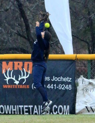 Image: A shot of Goliad's centerfielder who was unable to catch Italy's Jaclynn Lewis's third over-the-fence homerun during the 5th and final game of the tournament. It was Lewis's 3rd straight fence clearer over 3 games.